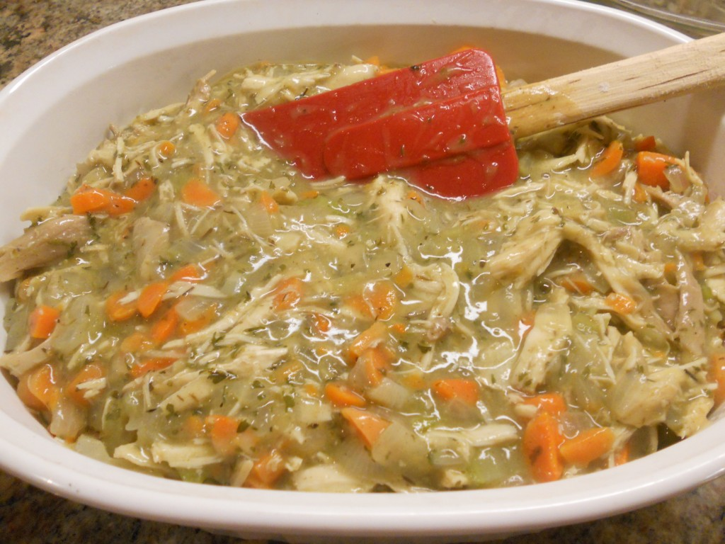 Layer the turkey-veggie mixture in the casserole dish.
