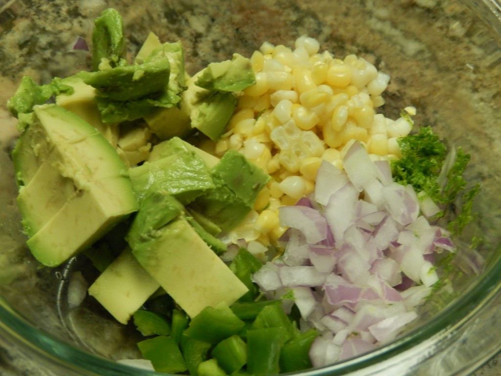 The salsa ingredients get mixed together.