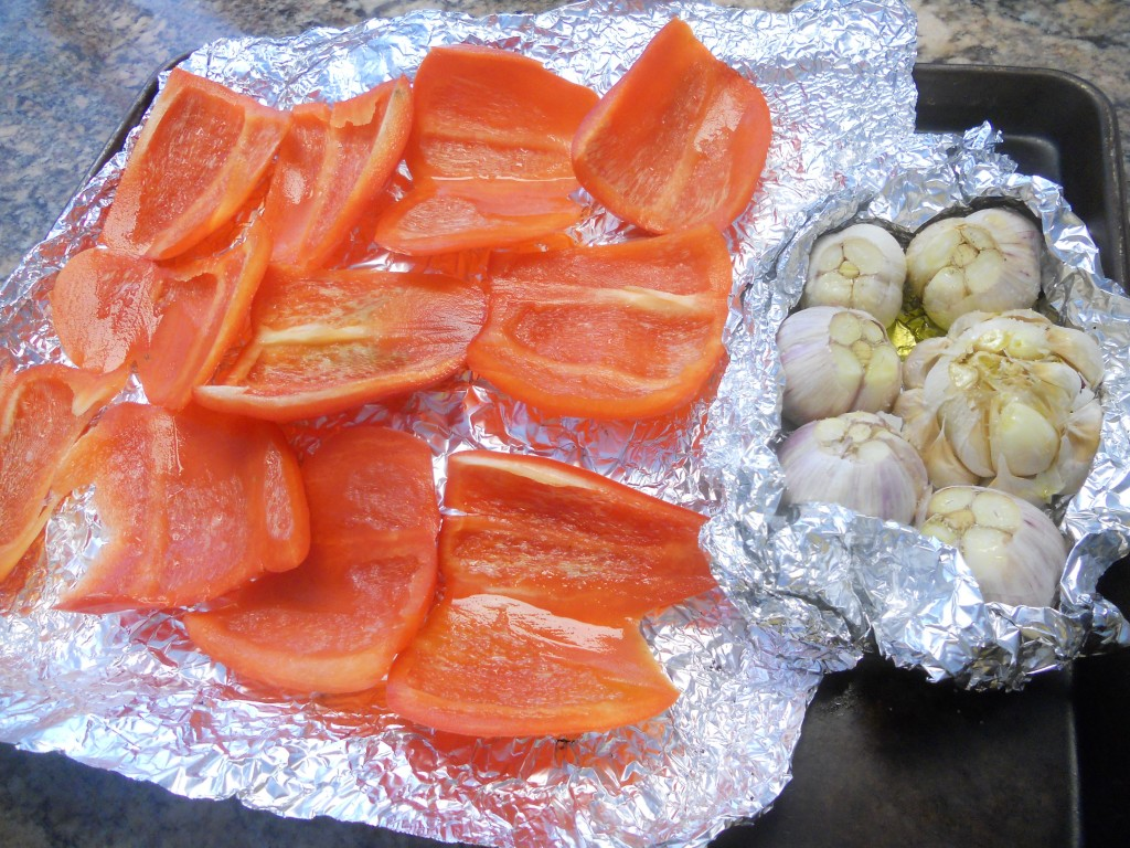 We prefer the grill to the oven to roast the peppers & garlic, but either can be used.