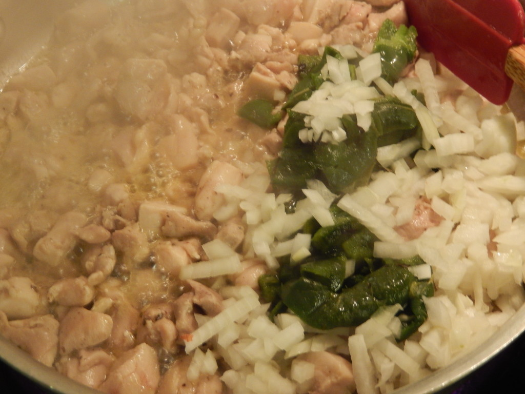 The onion & poblanos get added to the chicken pieces.