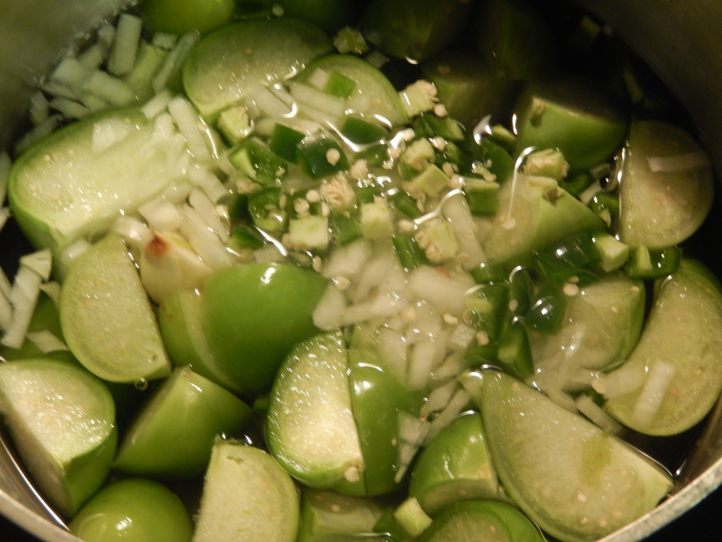 The making of the tomatillo sauce.