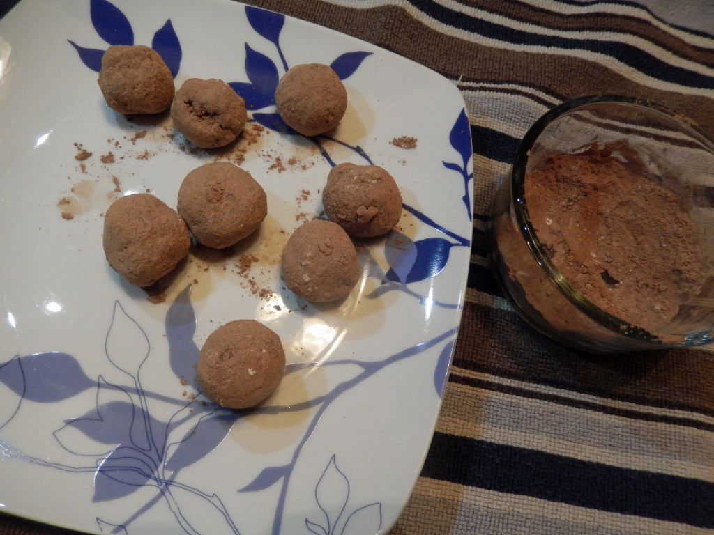 Roll the dough into balls & in the cocoa/sugar mix.