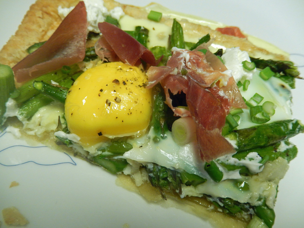 The prosciutto, goat cheese & scallions are added after the tart is cooked.