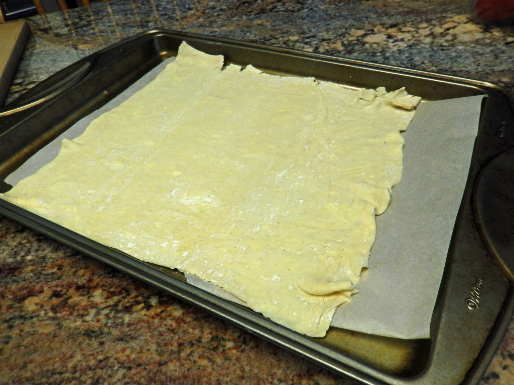 Roll out the puff pastry making an edge on it to contain the add-ons.