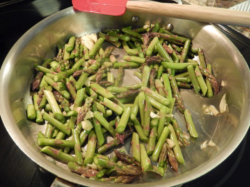 Saute the garlic & asparagus.