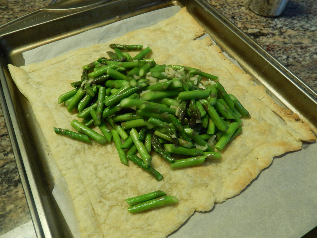 Transfer the asparagus mixture to the baked pastry.