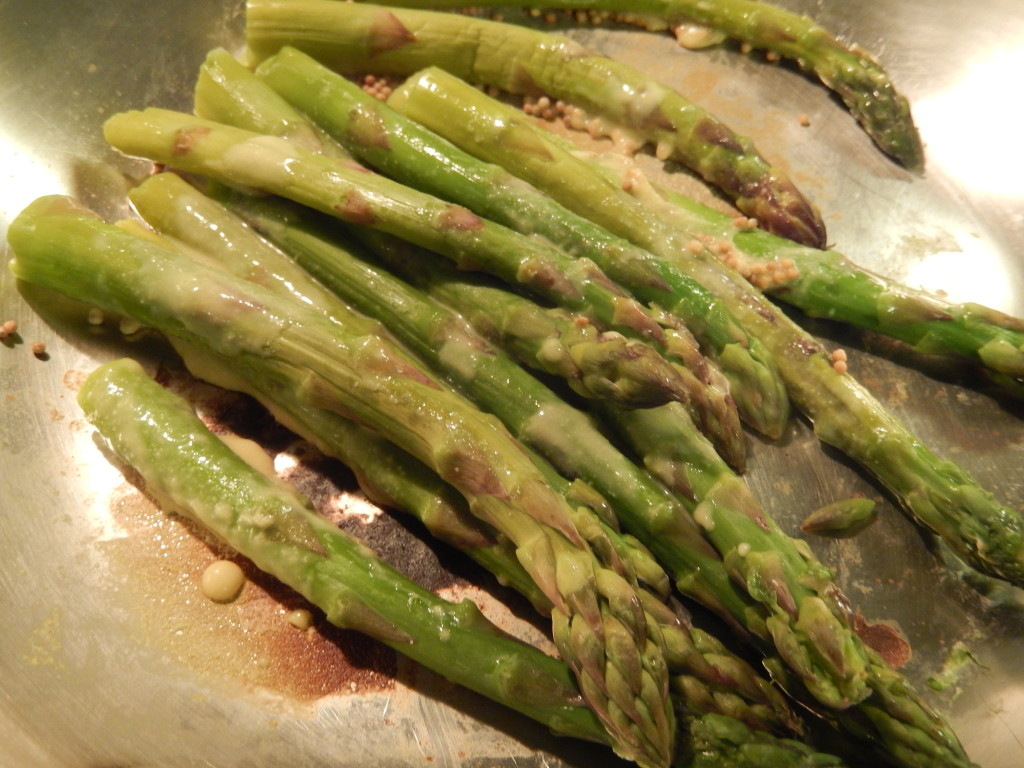 When the mustard seeds start to pop, add in the asparagus & dressing.
