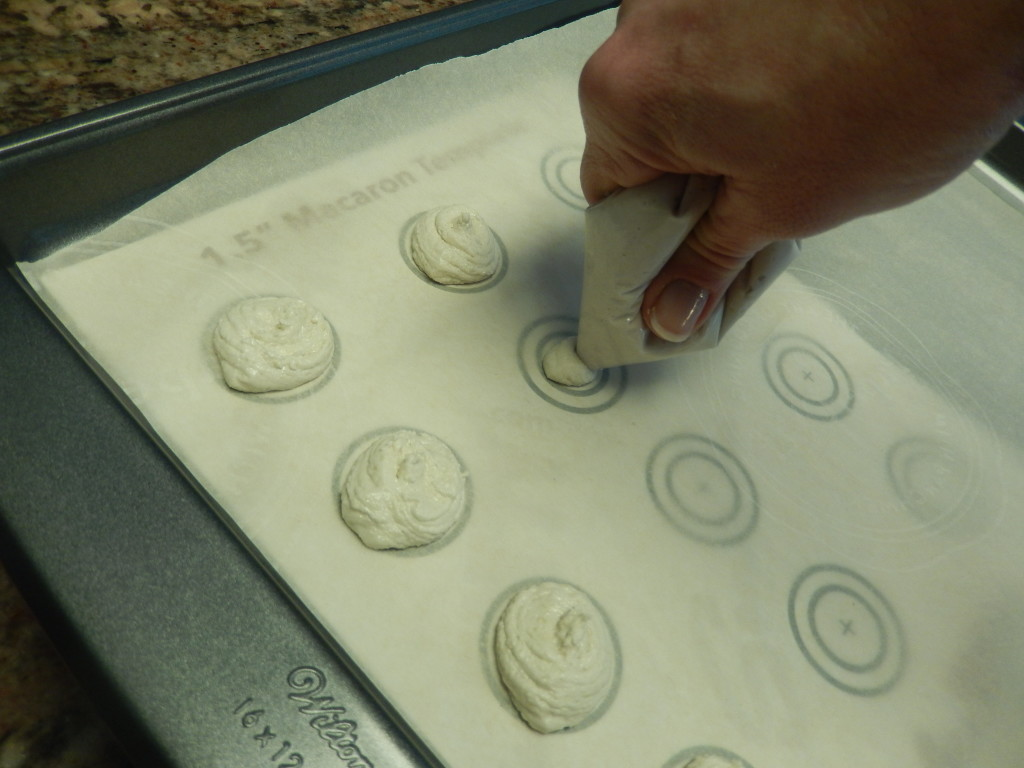 Pipe the batter onto the parchment paper in rounds.