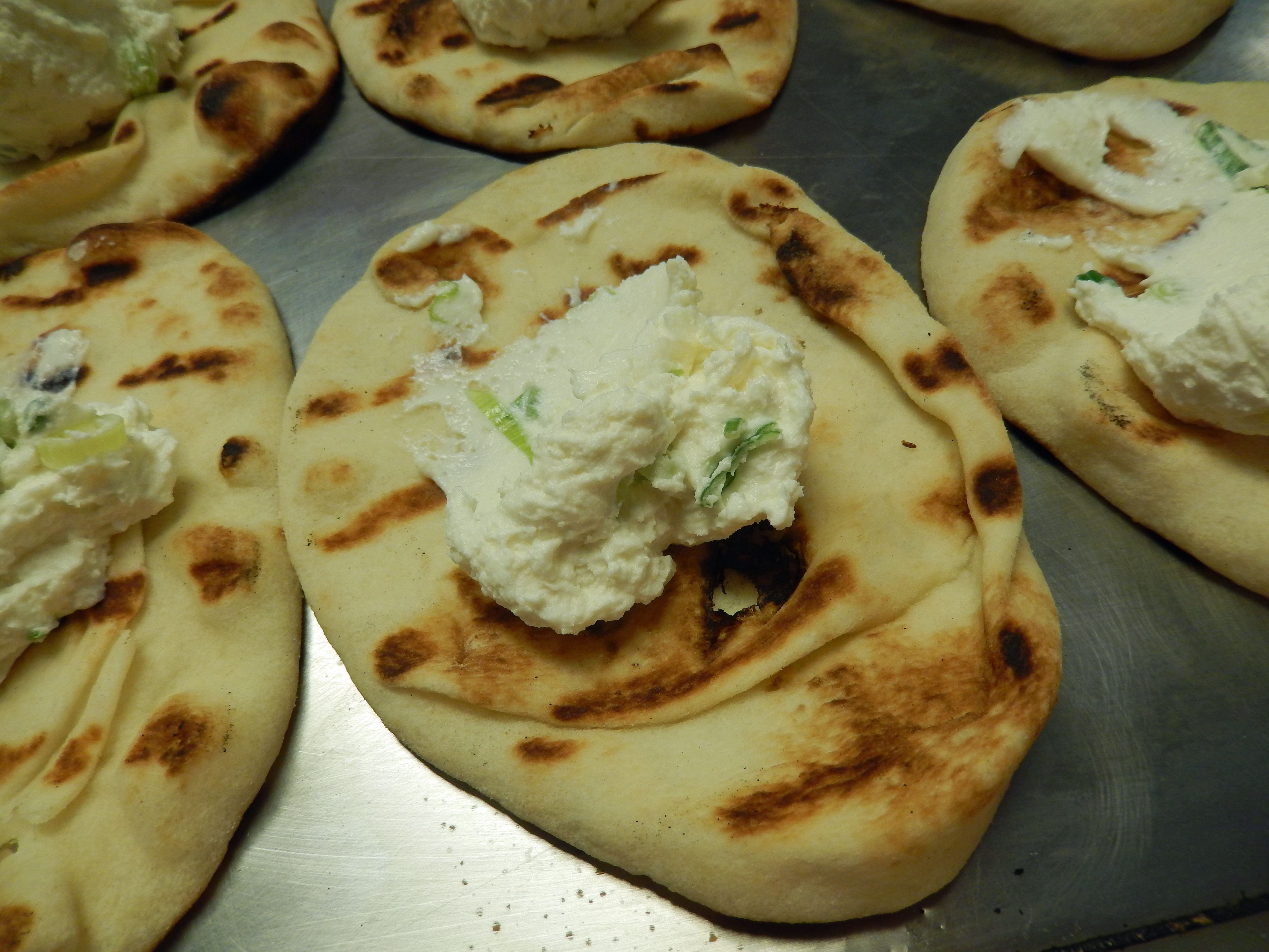 Spread the whipped cheese mixture on the flatbreads.