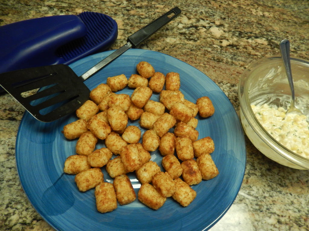 Cook the tater tots as the package instructs.