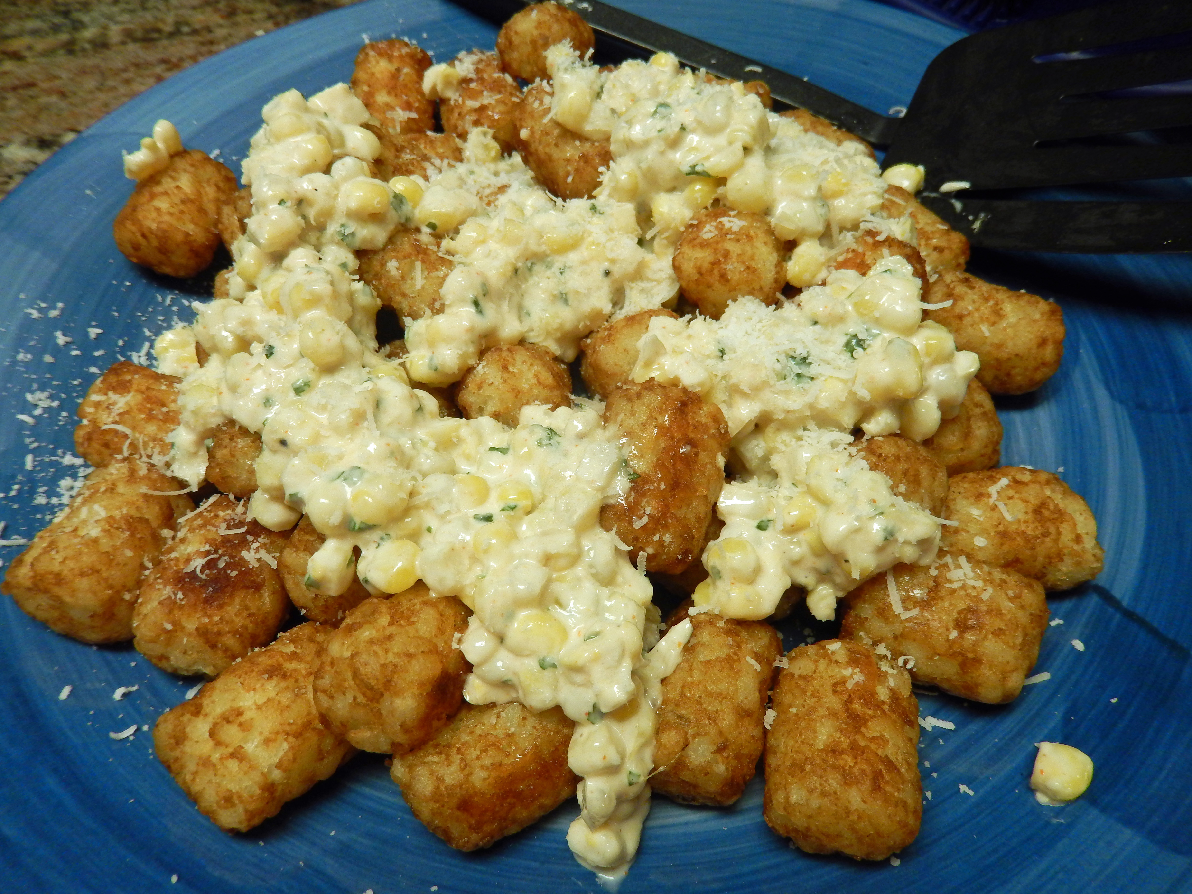 Tater tots plus spicy corn in a creamy sauce is a great side dish!