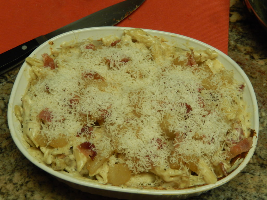 Top the mac & cheese with the reserved bacon and the Parmesan cheese.