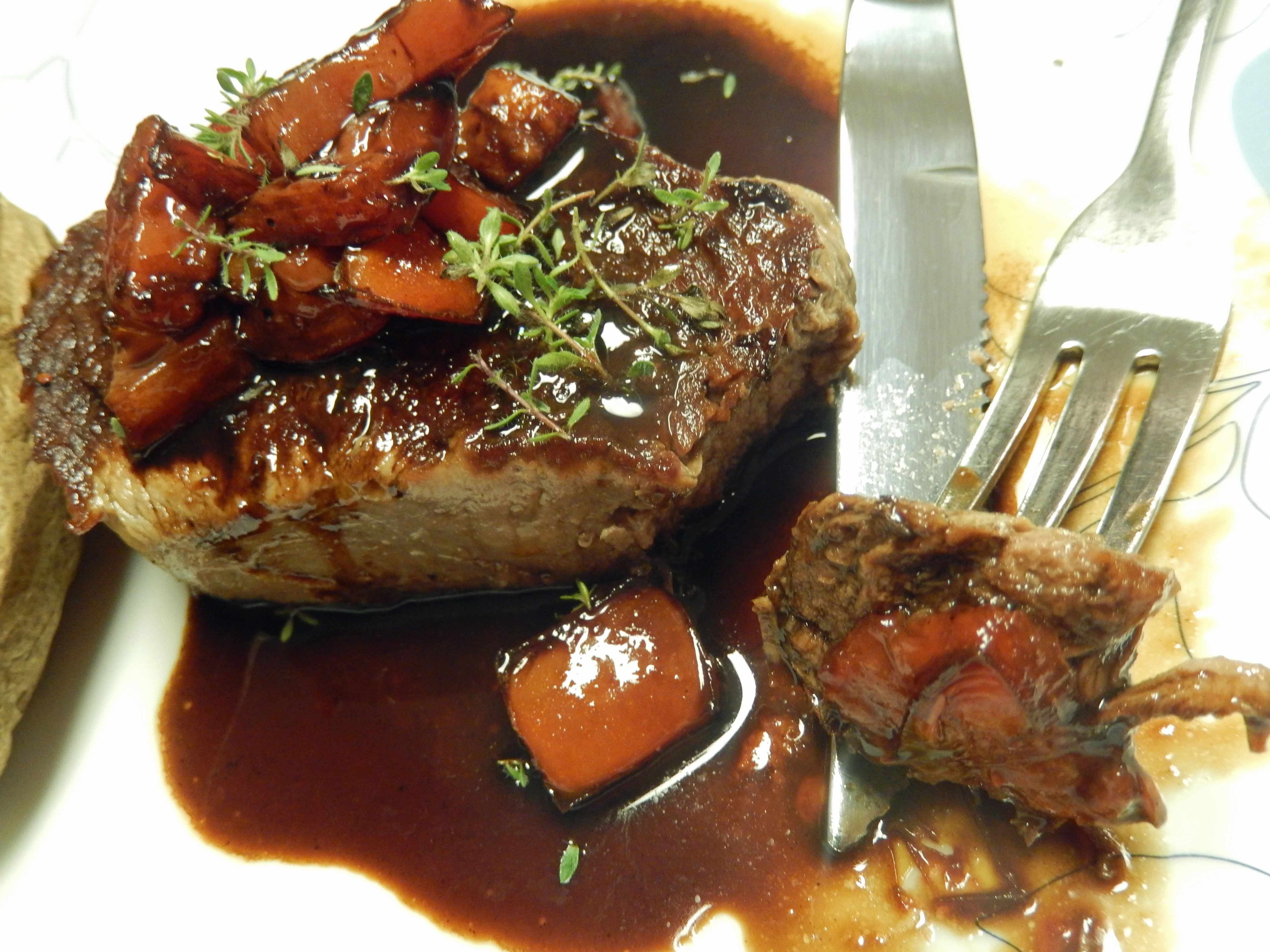 Spoon the tomatoes in the balsamic reduction and the fresh thyme over the steaks to serve.